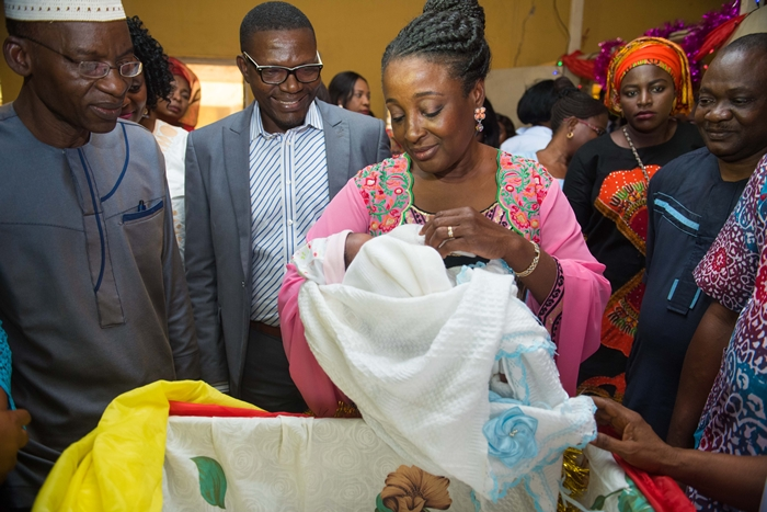 The wife of the Edo State Governor, Mrs. Betsy Obaseki, carrying one of the first babies born in 2018 at the Central Hospital, Benin City on January 1, 2018. She is flanked by the Chief Medical Director, Central Hospital, Benin City, Dr. Philip Ugbodaga (2nd from left).