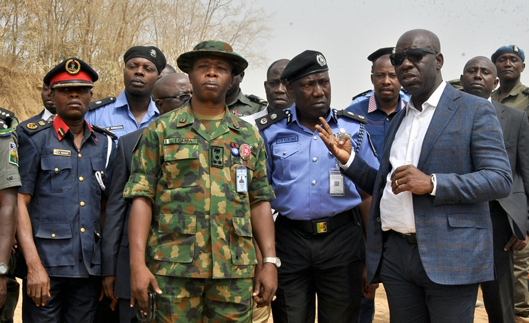 Governor of Edo State, Mr. Godwin Obaseki (right), flanked by the Commissioner of Police, Edo State, Mr. Johnson Kokumo (2nd right); Commander of 4 Brigade, Nigerian Army, Major General Ibrahim Garba (2nd left); and the Edo State Commander, Nigeria Security and Civil Defence Corps (NSCDC), Mr. Makinde Ayinla at the Obu mine site in Okpella, Edo State, where they arrested officials of BUA Int'l Limited for violating a Stop Work Order, on Wednesday, January 3, 2018.