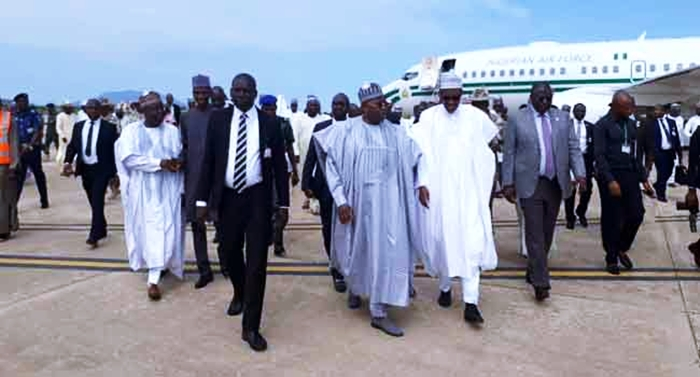 President Muhammadu Buhari walks with Governor Muhammed Abubakar during his visit to Bauchi State on June 21, 2018.