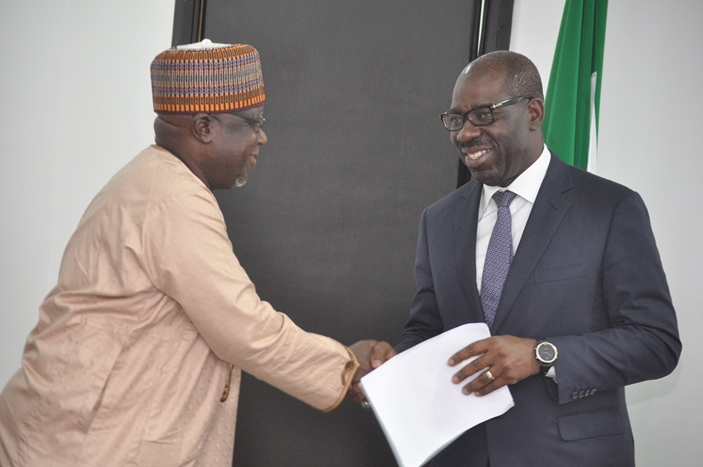 Edo State Governor, Mr. Godwin Obaseki (right), receiving souvenir from the National President, Association of National Accountants of Nigeria (ANAN), Alhaji Shehu Ladan, during a courtesy visit by ANAN officials to the governor, at the Government House in Benin City on Monday.