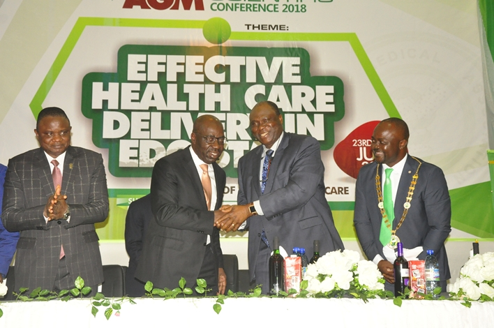 Edo State Governor, Mr. Godwin Obaseki (second left); Commissioner for Health, Hon. David Osifo (left); Chairman, Edo State Chapter of the Nigerian Medical Association (NMA), Dr. Emmanuel Osaigbovo (right); and Dr. Osagie Dawodu (second right), during the NMA's Annual General Meeting and Scientific Conference, in Benin City, Edo State.