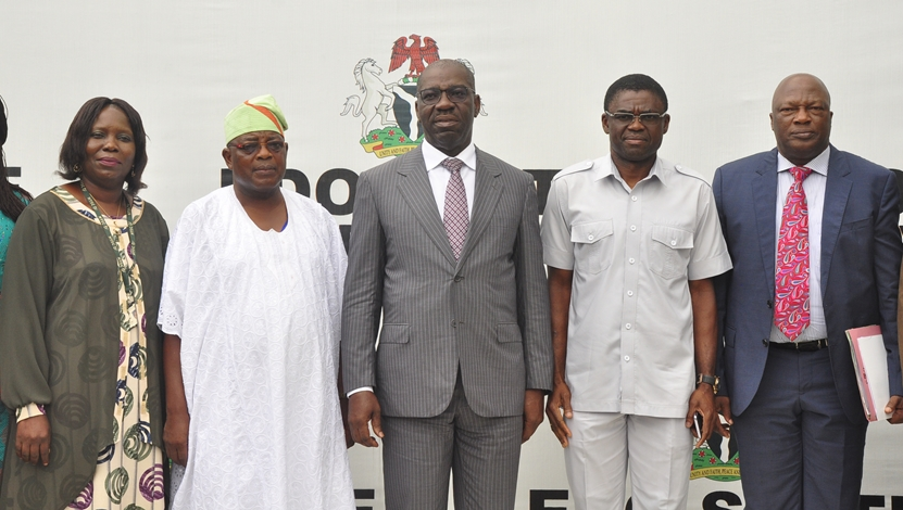 Edo State Governor, Mr Godwin Obaseki (middle); Deputy Governor, Rt. Hon. Philip Shaibu (second right); Secretary to the State Government, Osarodion Ogie Esq. (right); Edo State Coordinator of the National Youth Service Corps (NYSC), Mr Adebayo Ojo (second left); and Assistant Director to the State Coordinator, Mrs. Stella Igechi (left), during the courtesy visit by the NYSC State Coordinator, to the governor, at the Government House, in Benin City, on Monday, July 30, 2018.
