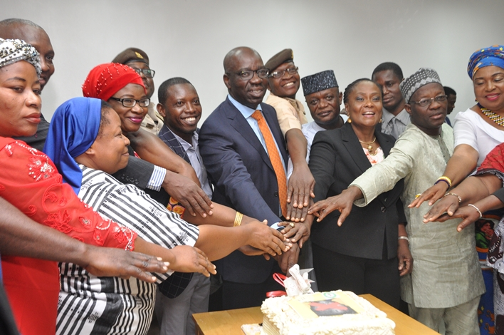 Edo State Governor, Mr. Godwin Obaseki (4th left), with members of the State Executive Council and stakeholders in the fight against human trafficking and illegal migration, during a presentation to mark the one-year anniversary of the Edo State Task Force Against Human Trafficking at the Weekly State Executive Council Meeting at the Government House, in Benin city, on Wednesday, August 15, 2018.