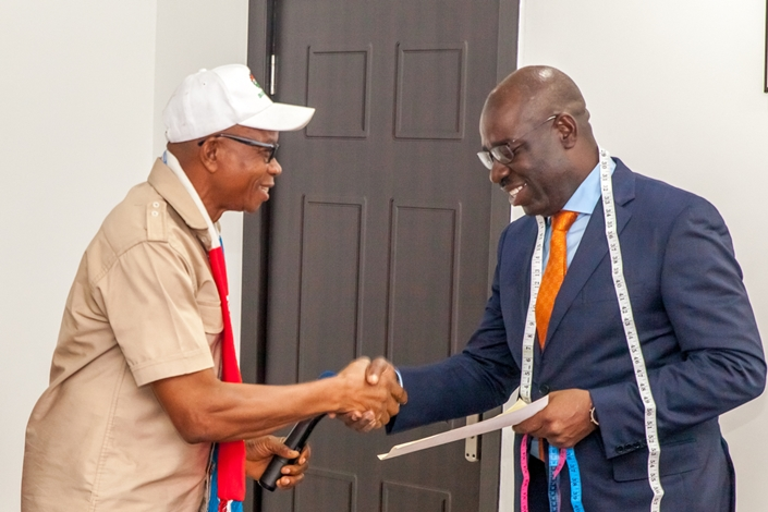Edo State Governor, Mr. Godwin Obaseki (right); and the State Chairman, National Union of Textile, Garment and Tailoring Workers of Nigeria, Comrade Isaiah Okungbowa, during the courtesy visit by the executive members of the Union to the governor, at Government House, Benin City.