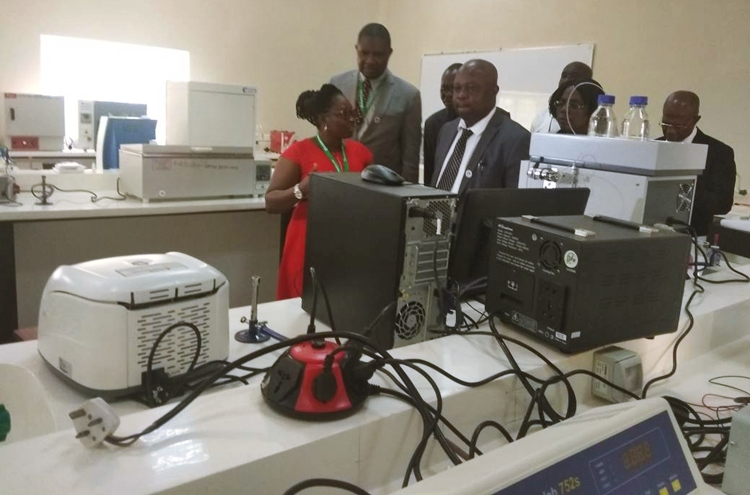 Edo State Commissioner for Education, Barr. Emmanuel Agbale (2nd left), with staff of Edo University, Iyamho in one of the laboratories, during a visit to the university, in Iyamho, Etsako West Local Government Area, Edo State.