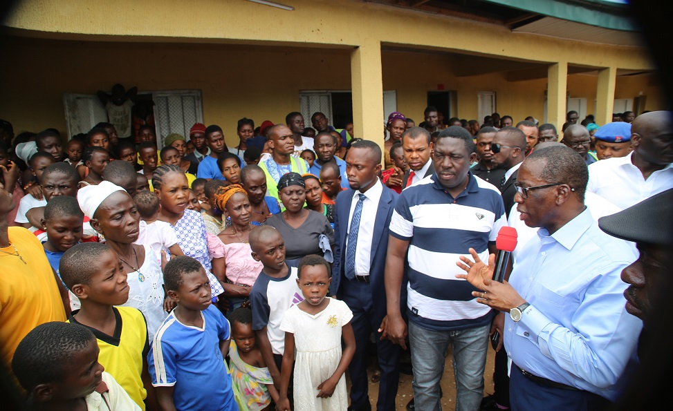 Delta State Governor, Senator Ifeanyi Okowa (right), flanked by the Commissioner, Bureau for Special Duties, Barr. Ernest Ogwezzy, addressing victims of the current flood at One Primary School holding camp in Asaba.