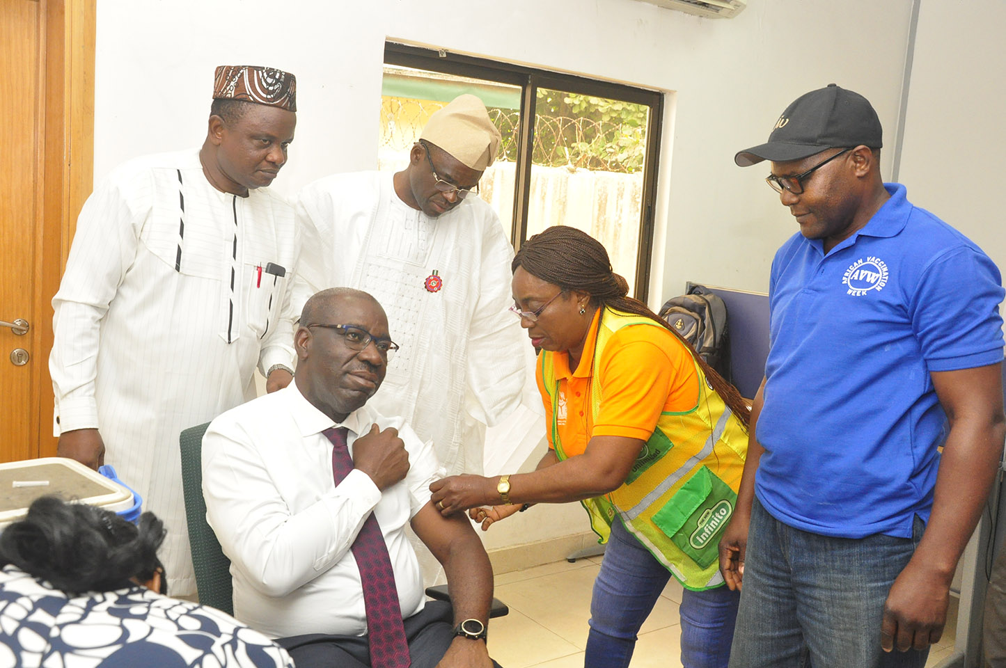 Edo State Governor, Mr. Godwin Obaseki taking a shot of the yellow fever vaccine, at the end of the weekly EXCO meeting at Government House, Benin City, Edo State. He is flanked by his deputy, Rt. Hon. Philip Shaibu (back row, right); and Commissioner for Health, Dr. David Osifo.