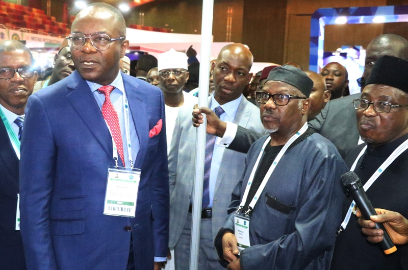 L-R: Minister of State for Petroleum Resources, Dr. Ibe Kachikwu,who Represent President Muhammadu Buhari;Group Executive Director, Government and Strategic Relations, Dangote Industries Limited, Engr. Mansur Ahmedand the Group Managing Director NNPC Engr. Maikanti Baro at the Dangote Exhibition Stand at the Two-Day Nigeria International Petroleum Summitin Abuja on January 28, 2019