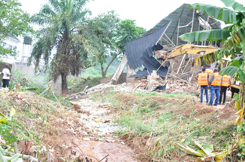 One of the illegal structures constructed on a moat being removed by officials of the Edo State Ministry of Physical Planning and Urban Development, in Ugbor Community, on Tuesday, July 2, 2019.