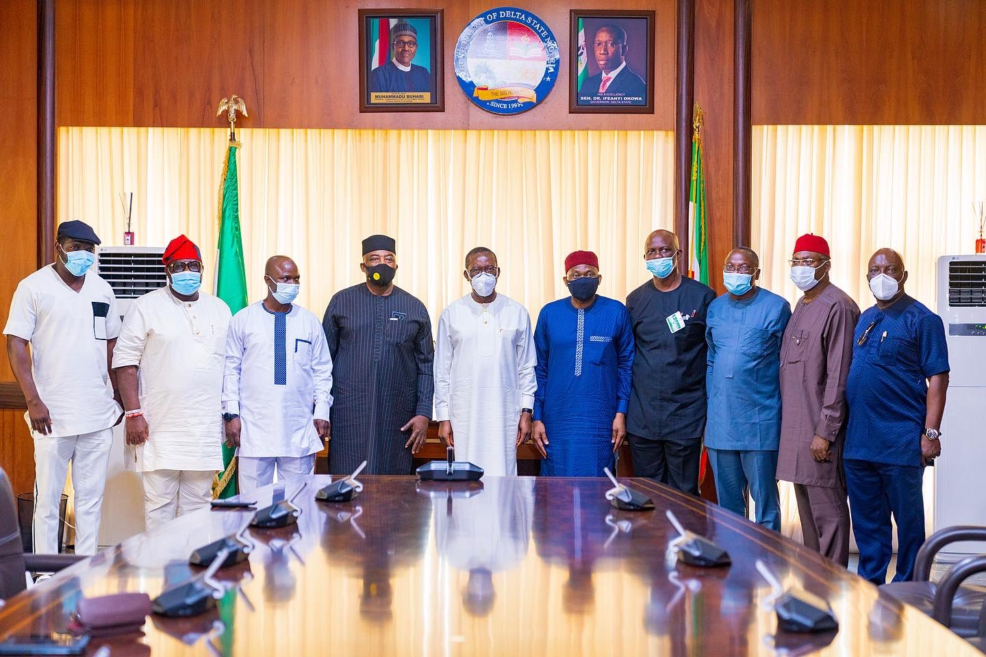Delta Governor, Senator Dr. Ifeanyi Okowa (5th left) Minority Leader, Federal House of Representatives, Rt. Hon. Ndudi Elumelu (5th right), Hon. Julius Pondi, (left), Hon. Thomas Ereyetomi, (2nd left), Hon. Ben Igbakpa (3rd left)and Hon. Leo Ogor, (4th left), Hon. Victor Nwokolo,(4th right), Hon. Ejiroghehne Waive (3rd right), Hon. Ossai Nicholas Ossai, (2nd right) and Hon. Efe Afe, (right) during a solidarity visit by members of Delta caucus in the Federal House of Representatives to the Governor in Asaba over destruction of public infrastructure during the EndSARS Protest on Wednesday, October 28, 2020