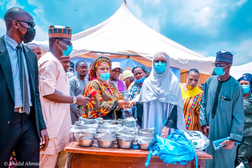 (2nd Right) The Honourable Minister of Humanitarian Affairs, Disaster Management and Social Development, Sadiya Umar Farouq, (3rd Right) the Representative of the Honourable Minister of State for FCT, Chiwendu Eteyen Amba, (1st Right) Director Humanitarian Affairs, Grema Ali Alhaji, and other dignitaries during the Hand over of Home-Grown School Feeding Utensils and Aprons to the FCT, on the 25th of May, 2021, at LEA Primary School Jabi, Abuja. Photo: Khalid Ahmed